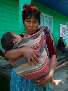 Babywearing makes it easier to transport children across the tough terrain of the mountain villages